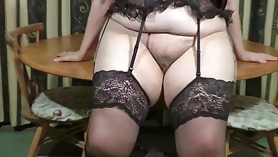 Striptease grandma in stockings