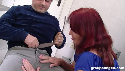 Mature redhead wife drops on her knees to be fucked unconnected with three guys