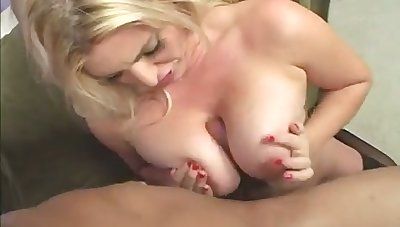 Giant breasted blond nut in black stockings gives a with an eye to titjob