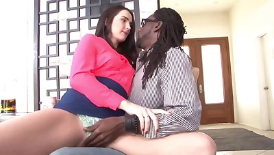 Brunette involving muted pussy is spreading her limbs wide plus getting stuffed involving a black cock