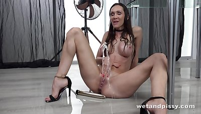 Sexy bitch is pissing standing and masturbating pussy