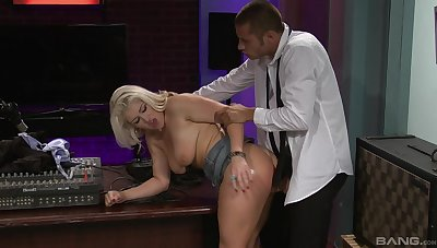 MILF fucked at the office and made to cream her boobs with jizz