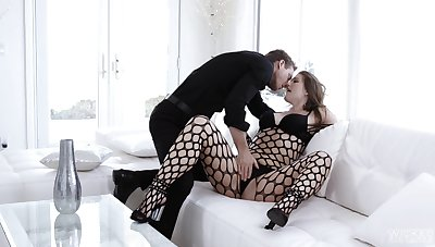 Sultry Ella Nova is wrapped in black fishnet during scintillating couch carnal knowledge