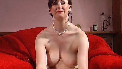 Horny MILF Lara Latex plays with her round Bristols and shaved pussy